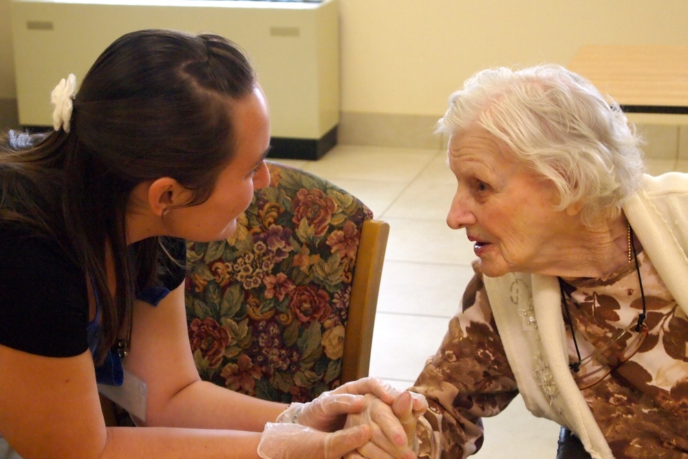 Sophomore student Elizabeth Post offers friendship to Martha, a resident of the Sacred Heart Residence in Mobile, Alabama