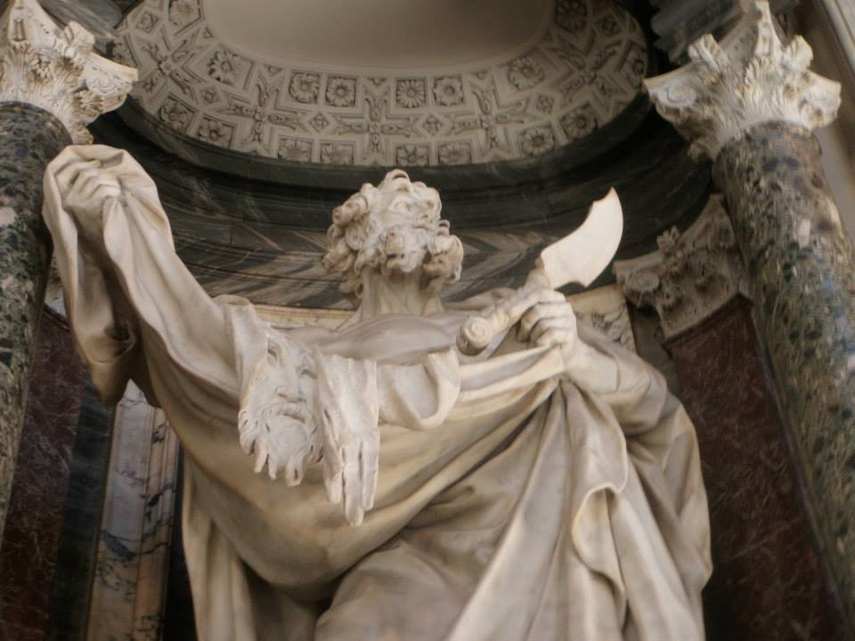 A Statue of Saint Bartholomew holding the flesh of his face and hands