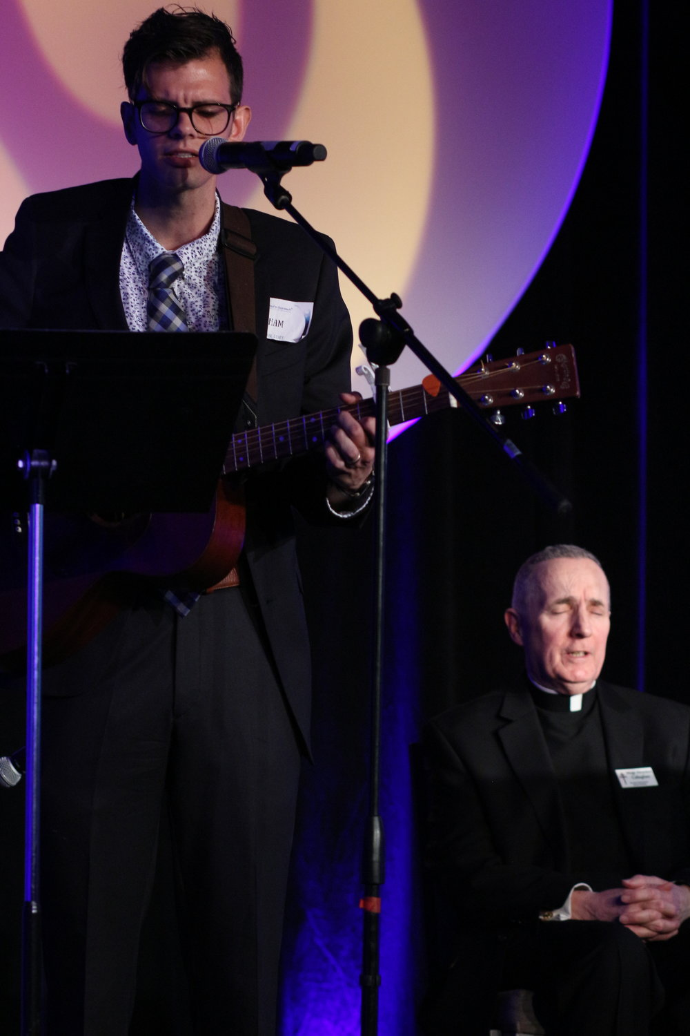 "Abe gross (left) led a rendition of ""Our Lady of Knock"" to honor  Msgr. Callaghan (right) after he was awarded the Bishop Paul Dudley Servant Leadership award."
