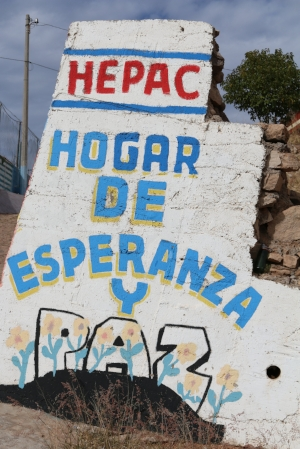"Sign as you enter HEPAC. English translation, ""HEPAC home of hope and peace"""