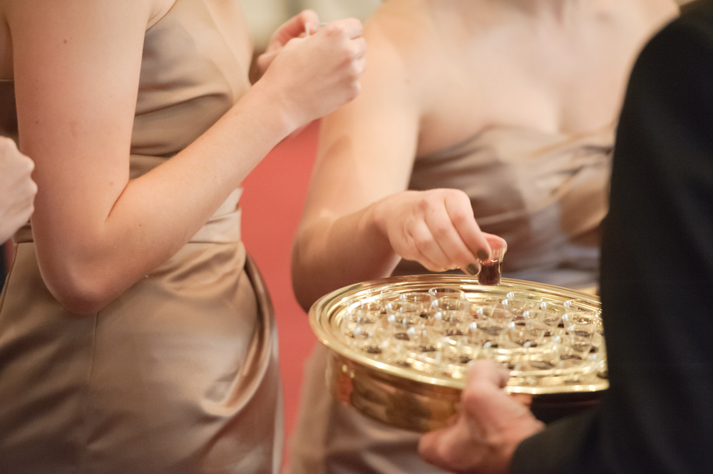 Bridesmaids taking communion.