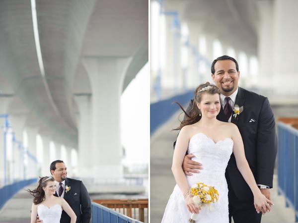 Bride and groom under bridge, standing.