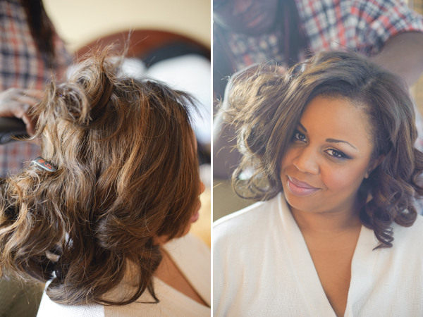 Hairstylist curling bride's hair