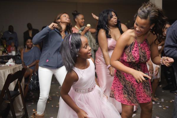 Flower girl and bridesmaid dancing.