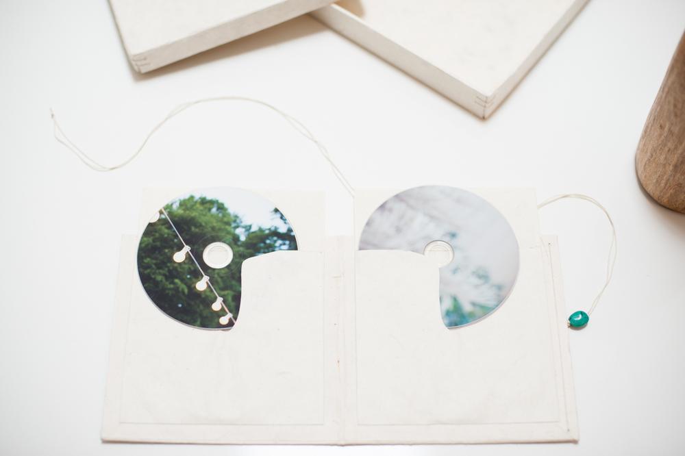 Custom-printed wedding photo DVDs.