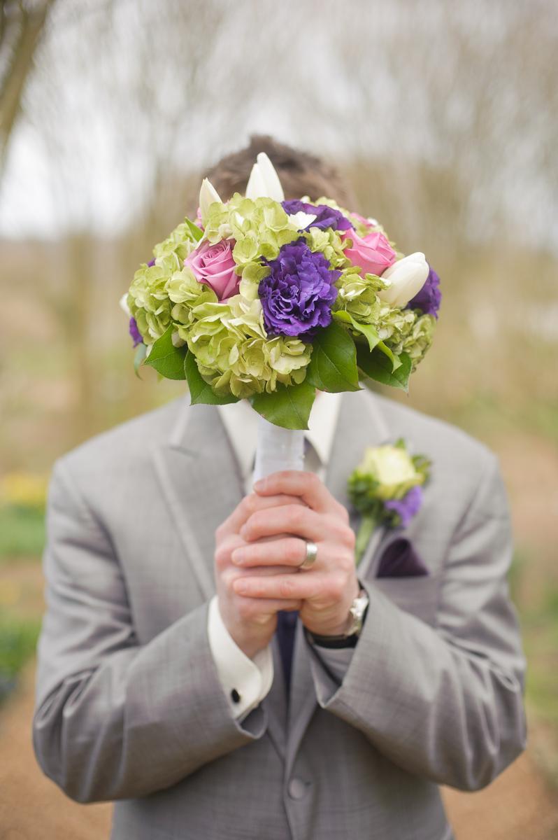 groom-with-flower-bouquet-nashville-wedding.jpg