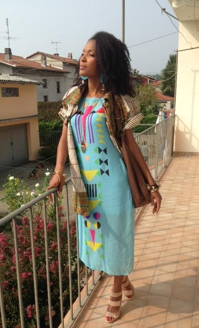 Claudia in Sindiso Khumalo Aretha Silk Georgette Dress with Heart 365 Nilot Earrings.