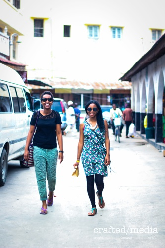 Mazuba and friend strolling through Stonetown captured by the Fest Guru's Crafted Media.