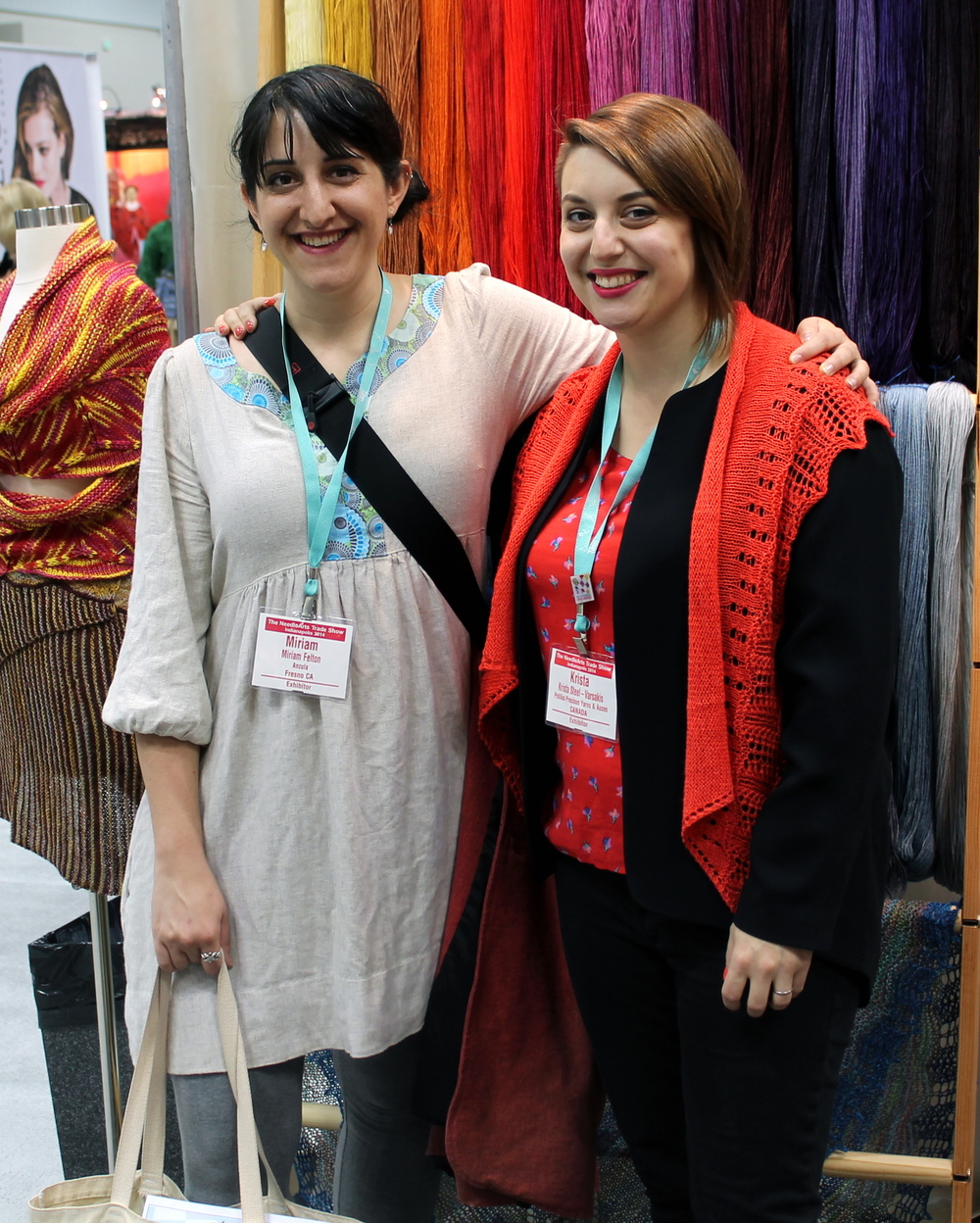 Miriam Felton and Krista in front of lovely Ancient Arts yarn!
