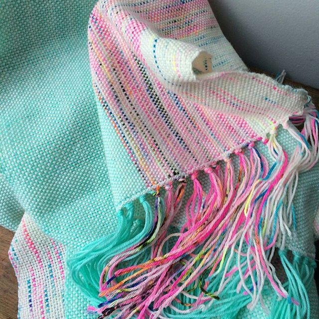 "Repost from @meganborg.  So stunning! Truly in awe of this beauty  In her words, ""I've been keeping my weaving adventures over @secretwoolsociety but I had to share my finally finished woven scarf 💕 I made it using leftover @raincityknits and @hedgehogfibres sock yarns 💙 Pssst I'm teaching the #cricketloom class over @stashlounge if you're interested in learning how to weave pretty things like this  Thanks @meganborg for sharing"