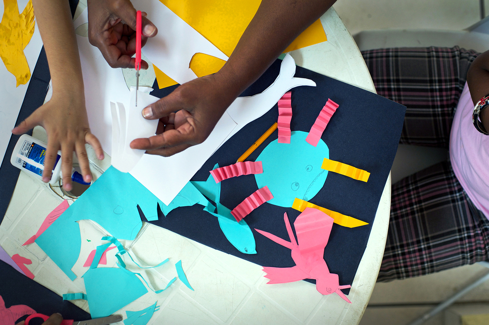 Students are encouraged to express themselves through tactile creative exercises.