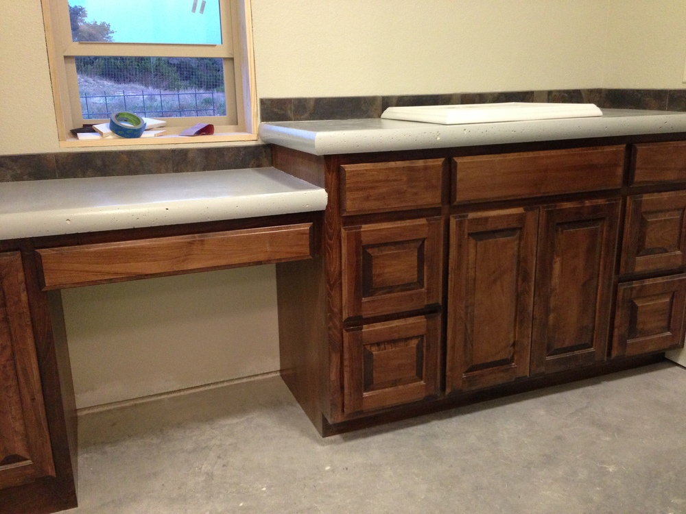 Master bath. The counter tops turned out great....have I mentioned how much I love these cabinets :)??? This has been grouted and is now ready for the sink and water to be hooked up.  We also have finished the jack and jill bath, photos to come.