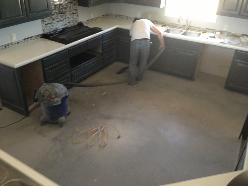 Preparing to finish the flooring.