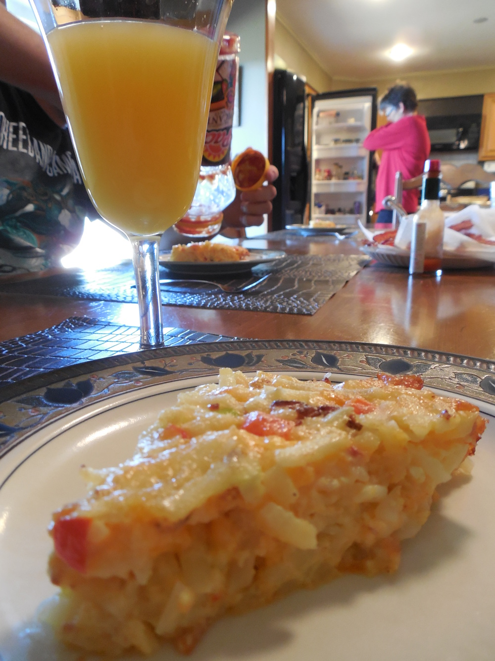 Each year it seems to be made a bit differently, but always tastes amazing! This year it included hash browns, bacon bits, a variety of peppers and of course egg!!!! Have a slice with salsa and your mimosa and your holiday will be complete!.....oh and with family :)