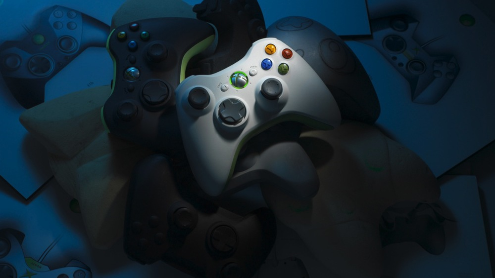 The Xbox 360 controller sitting on a pile of prototypes, models, and sketches.