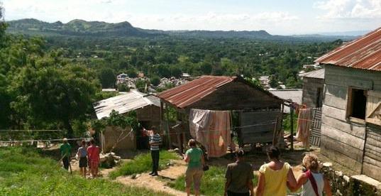 2011 DR team walks to visit children's homes.