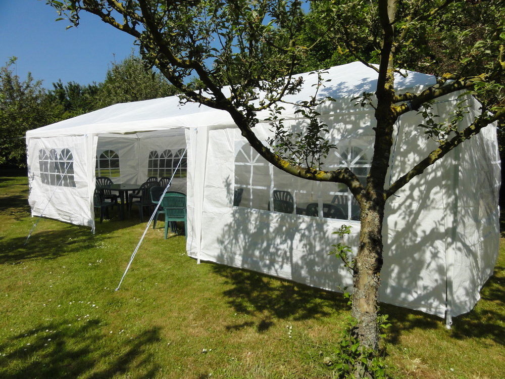 Small party marquee set up in the orchard