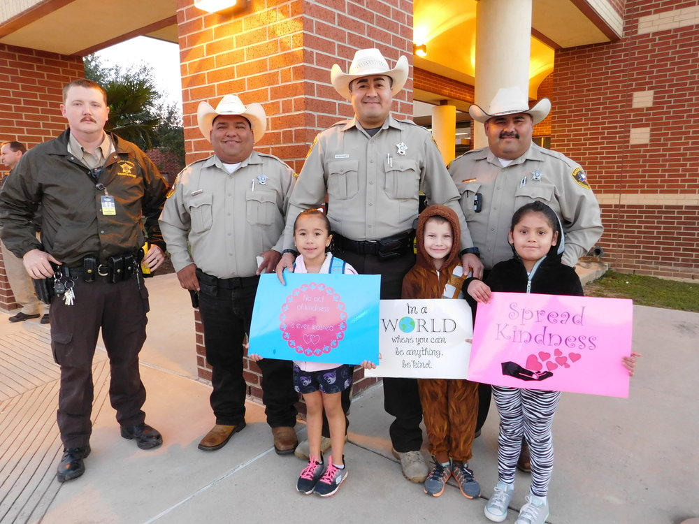 Law Enforcement Greeting Our Kids