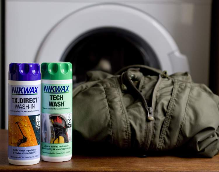 Buy Nikwax Tech Wash - this washes your outdoor gear, revives breathability and reinvigorates Durable Water Repellency [DWR] and TX Direct for making your waterproof waterproof again.  What's more, Nikwax doesn't need a tumble drier to kick it into action making it more environmentally friendly.  Twin pack of Tech Wash and TX Direct [300ml] around £11.25.