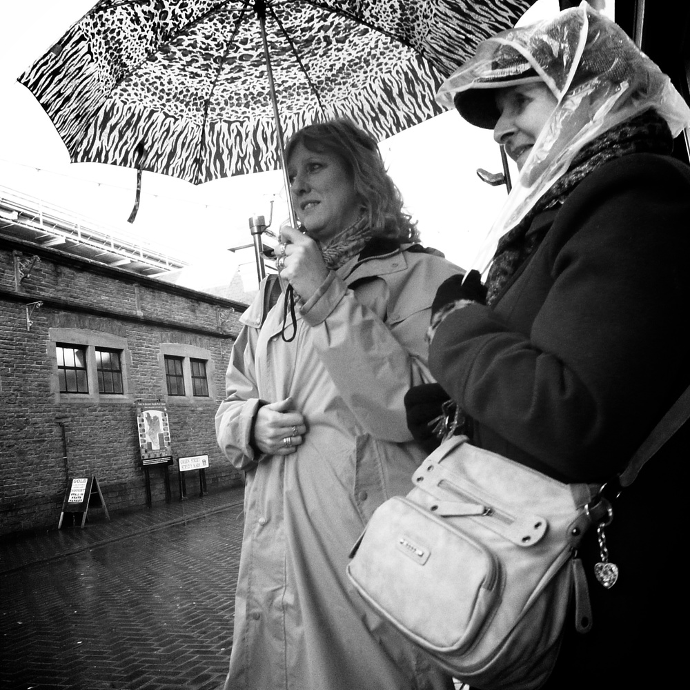 two ladies shopping on Queen Street, Neath, South Wales