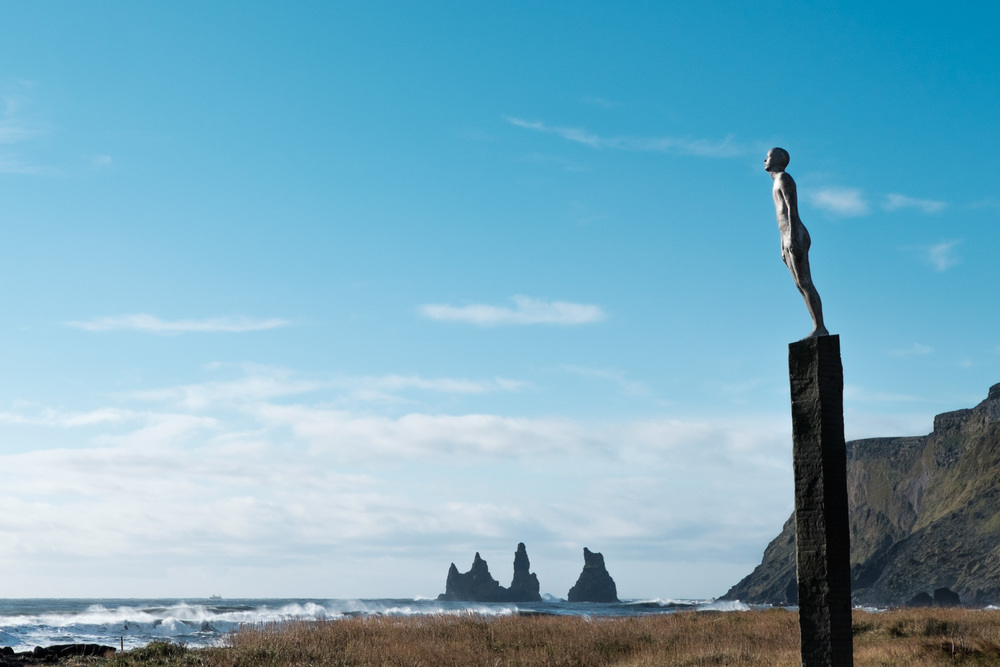 a statue on the black sand beach of Vik, Iceland. photo by me.