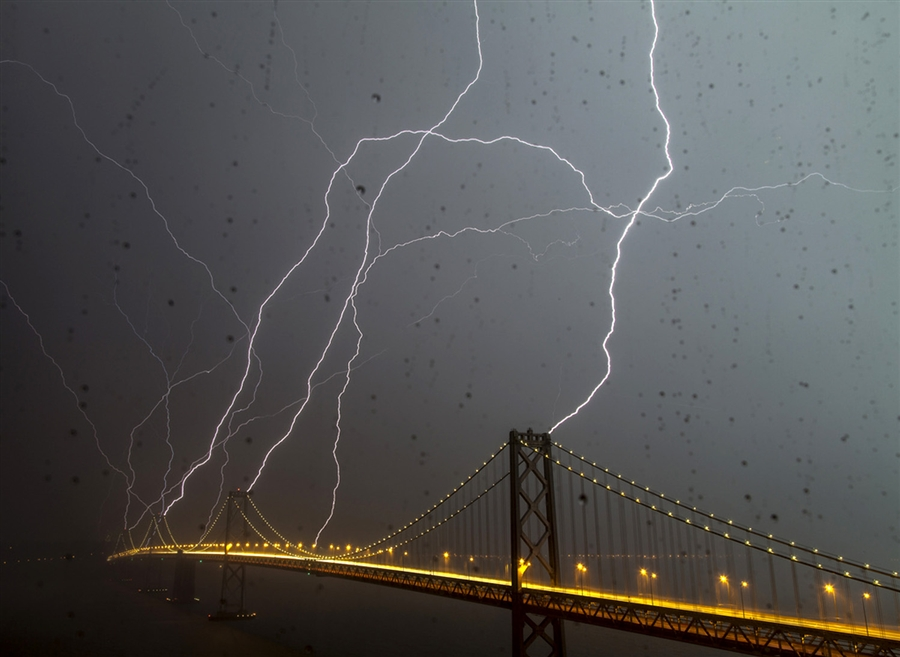 Last night we had an incredible storm in SF. I'm still in awe of these pictures of lightning striking the Bay Bridge.