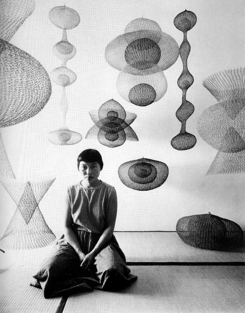 Ruth Asawa in her home with her crocheted wire sculptures, 1954.