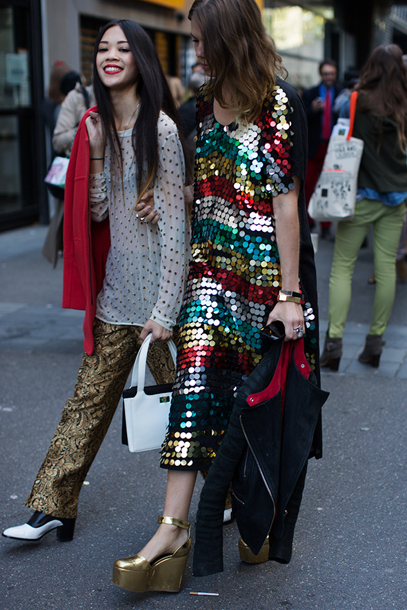I love the mixing of patterns, textures and colors. The shoes, the red lips and the striped sequins. God damn, now that's a combo. (The Sartorialist)