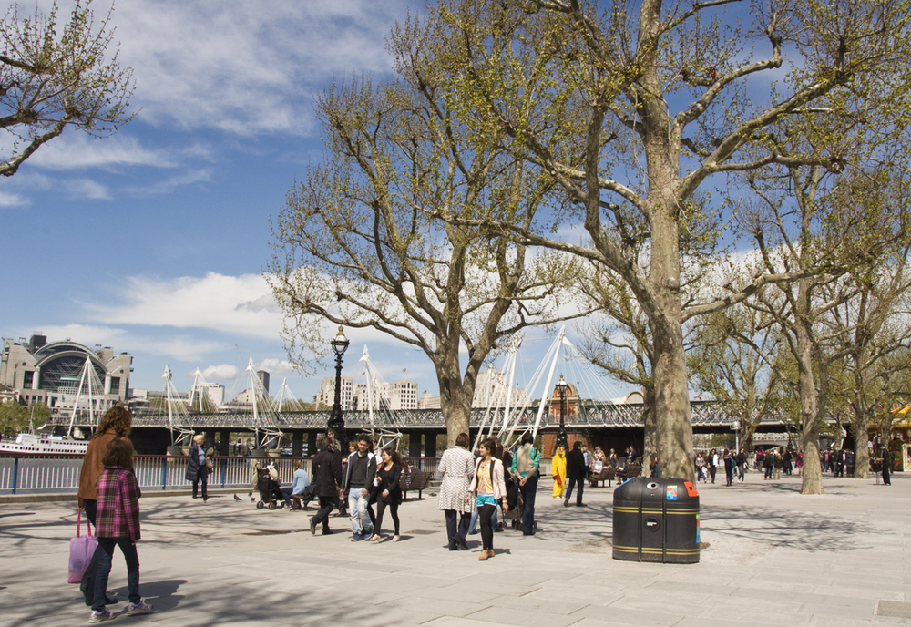 Walking along the south bank of the Thames in London sm.jpg