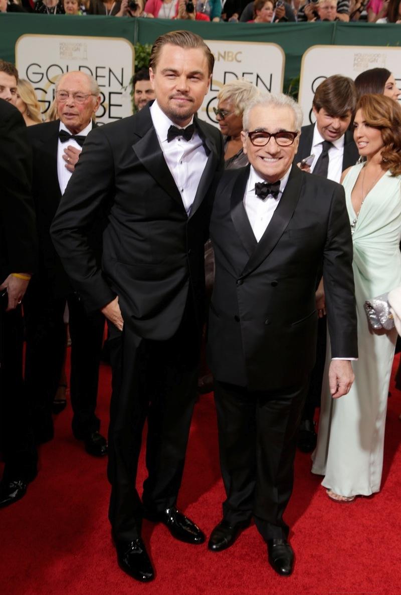 """A dupla formada por Leonardo DiCaprio e Martin Scorsese mostrou que anda afinada muito além das telas. Premiado por seu papel em """"O Lobo de Wall Street"""", DiCaprio desfilou o penteado impecável de sempre. Ao seu lado, um Sorsese elegante como sempre. Dessa vez o blazer com abotoamento duplo deu o toque final com uma destreza sem igual."""