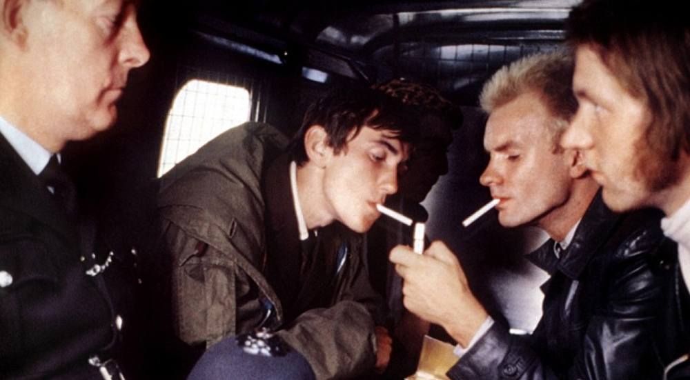 ace-face-jimmy-squad-car-smoking.jpg