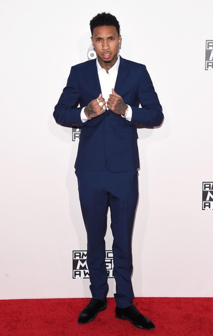 Tyga foi outro que mandou longe os estereótipos de rappers cheios de correntes e roupas folgadas. O costume azul sem gravata foi a escolha perfeita. Definitivamente um dos melhores da noite.