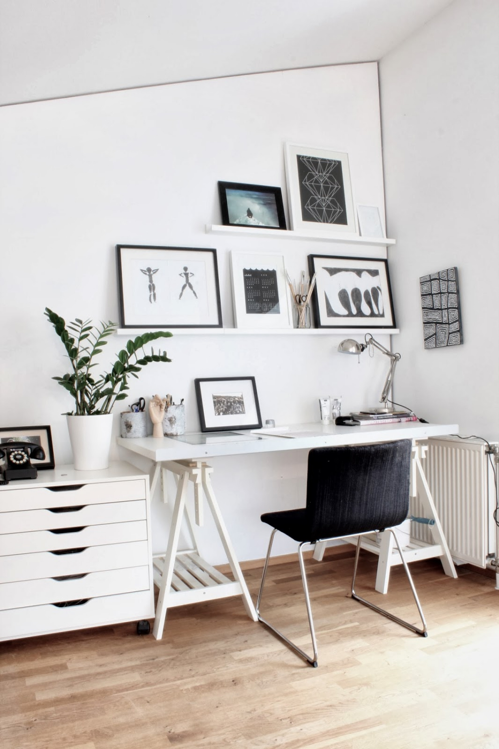 interior-exquisite-home-office-images-from-scandinavian-design-blogs-using-white-wooden-wall-shelves-and-a-silver-swing-arm-halogen-desk-lamp-also-with-a-rectangular-white-wooden-desk-and-black-stacki.jpg