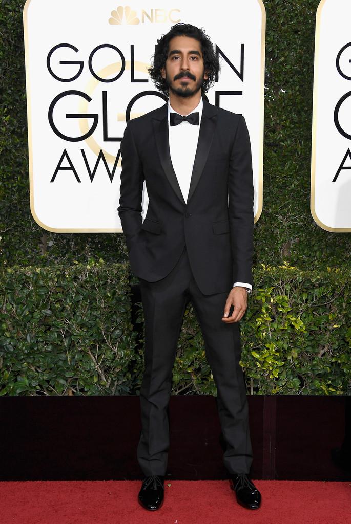 Dev Patel Frequentemente considerado um dos caras mais bem vestidos da atualidade, o jovem ator britânico não decepcionou. Simples, discreto, com um traje de medidas perfeitas e nenhum exagero. Destaque para a barba e o cabelo, mostrando que até no tapete vermelho tem espaço para isso.