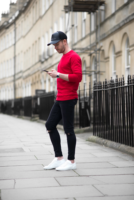 Mens-Fashion-Blogger-Red-Sweatshirt-Ripped-Black-Skinny-Jeans-Baseball-Cap-Outfit.jpg