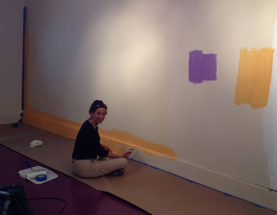 Rachel painting the media room where we will have slideshows and presentations.