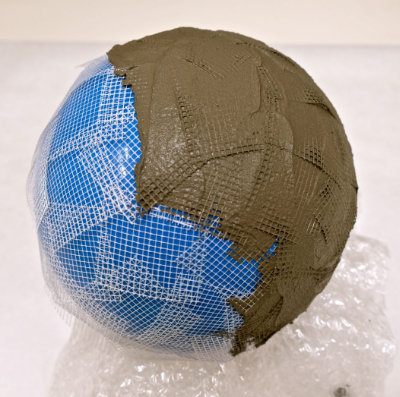 4. Use The Paddle To Spread The Parex, And Cover The Exposed Areas Of The  Ball And Mesh With A Thin Layer Of Concrete. You Will Not Be Able To Cover  The ...