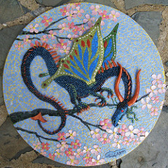 A mixed media eggshell dragon.