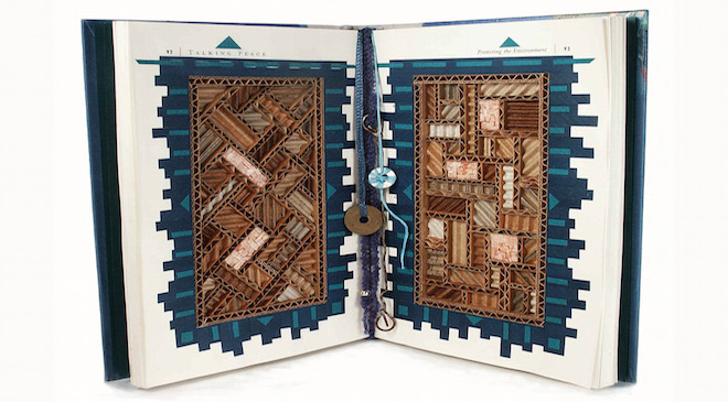 """Peace by Piece"" by Luci Lytle, finds mosaic composition in corrugated paper, nestled in an old book."