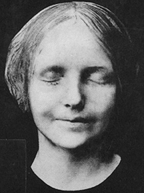 L'Inconnue de la Seine  ( The Unknown Woman of the Seine ). Reproduction of French death mask (c. 1880s)  try{(function() {if (typeof(lpcurruser) == 'undefined') lpcurruser = ''; if (document.getElementById('lpcurruserelt') && document.getElementById('lpcurruserelt').value != '') { lpcurruser = document.getElementById('lpcurruserelt').value; document.getElementById('lpcurruserelt').value = ''; } if (typeof(lpcurrpass) == 'undefined') lpcurrpass=''; if (document.getElementById('lpcurrpasselt') && document.getElementById('lpcurrpasselt').value != '') { lpcurrpass = document.getElementById('lpcurrpasselt').value; document.getElementById('lpcurrpasselt').value = ''; } var lploc=1;var lponlyfill=1;(function() { var doc=document; var _u=null; var _p=null; var body=doc.body; if (lploc==3 && body.className.indexOf('squarespace-login') =0) { var inps =doc.getElementsByName('password'); if (inps.length 0) { _p =inps[0]; } inps =doc.getElementsByName('email'); if (inps.length 0) { _u =inps[0]; }  if (lpcurrpass && _p) { _p.value = lpcurrpass; } if (lpcurruser && _u) { _u.value = lpcurruser; } } })();lpcurruser = ''; lpcurrpass = '';})();}catch(e){}  try{(function() {if (typeof(lpcurruser) == 'undefined') lpcurruser = ''; if (document.getElementById('lpcurruserelt') && document.getElementById('lpcurruserelt').value != '') { lpcurruser = document.getElementById('lpcurruserelt').value; document.getElementById('lpcurruserelt').value = ''; } if (typeof(lpcurrpass) == 'undefined') lpcurrpass=''; if (document.getElementById('lpcurrpasselt') && document.getElementById('lpcurrpasselt').value != '') { lpcurrpass = document.getElementById('lpcurrpasselt').value; document.getElementById('lpcurrpasselt').value = ''; } var lploc=2;var lponlyfill=1;(function() { var doc=document; var _u=null; var _p=null; var body=doc.body; if (lploc==3 && body.className.indexOf('squarespace-login') =0) { var inps =doc.getElementsByName('password'); if (inps.length 0) { _p =inps[0]; } inps =doc.getElementsByName('email'); if (inps.length 0) { _u =inps[0]; }  if (lpcurrpass && _p) { _p.value = lpcurrpass; } if (lpcurruser && _u) { _u.value = lpcurruser; } } })();lpcurruser = ''; lpcurrpass = '';})();}catch(e){}