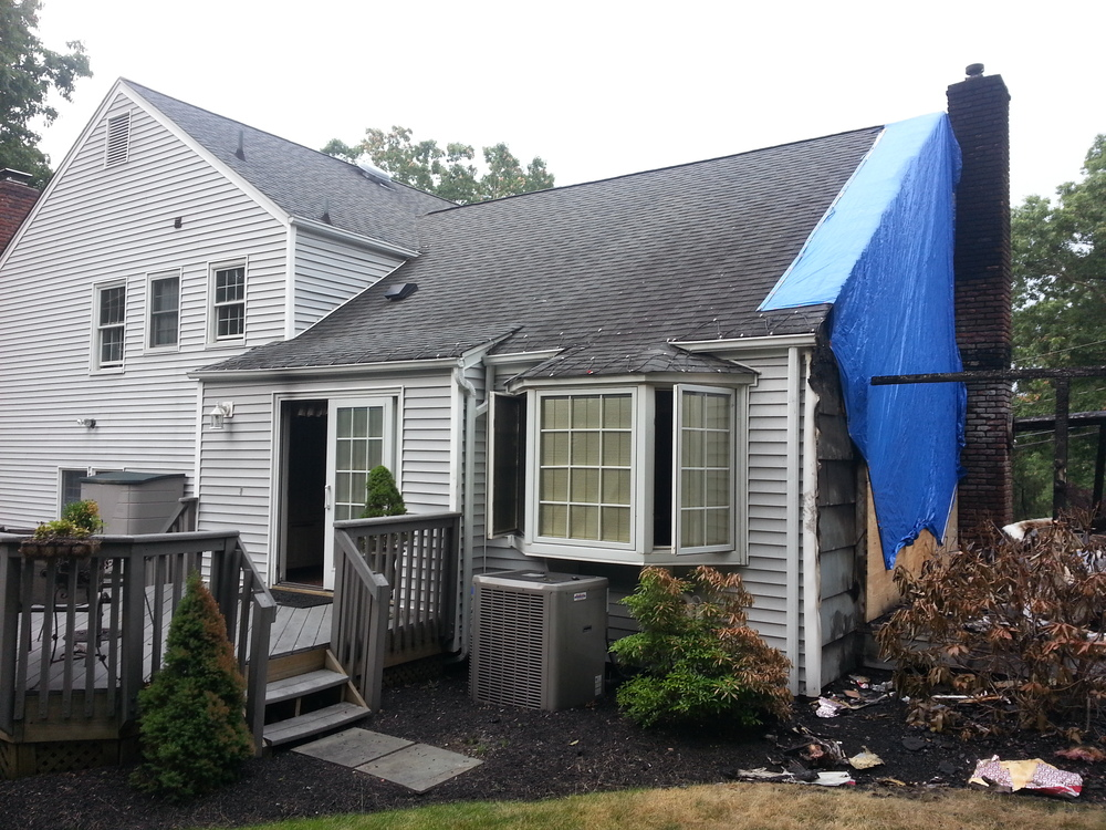 Fire damaged exterior before restoration by Groundswell Contracting