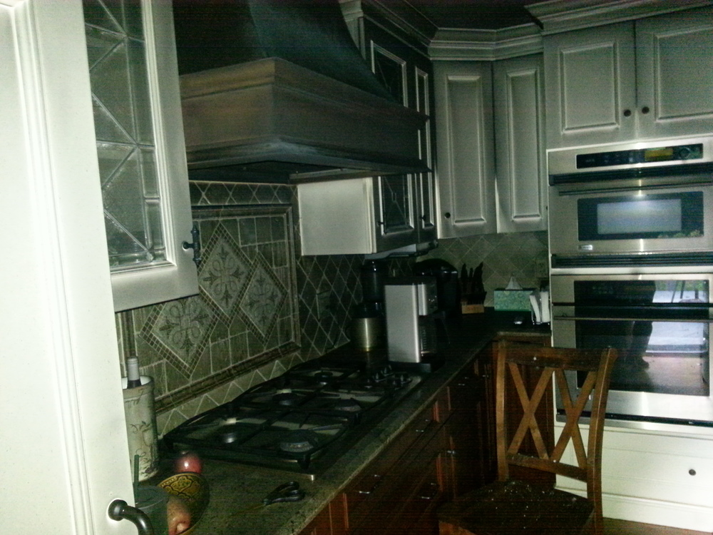 Fire and smoke damaged Wood Mode kitchen before restoration by Groundswell Contracting