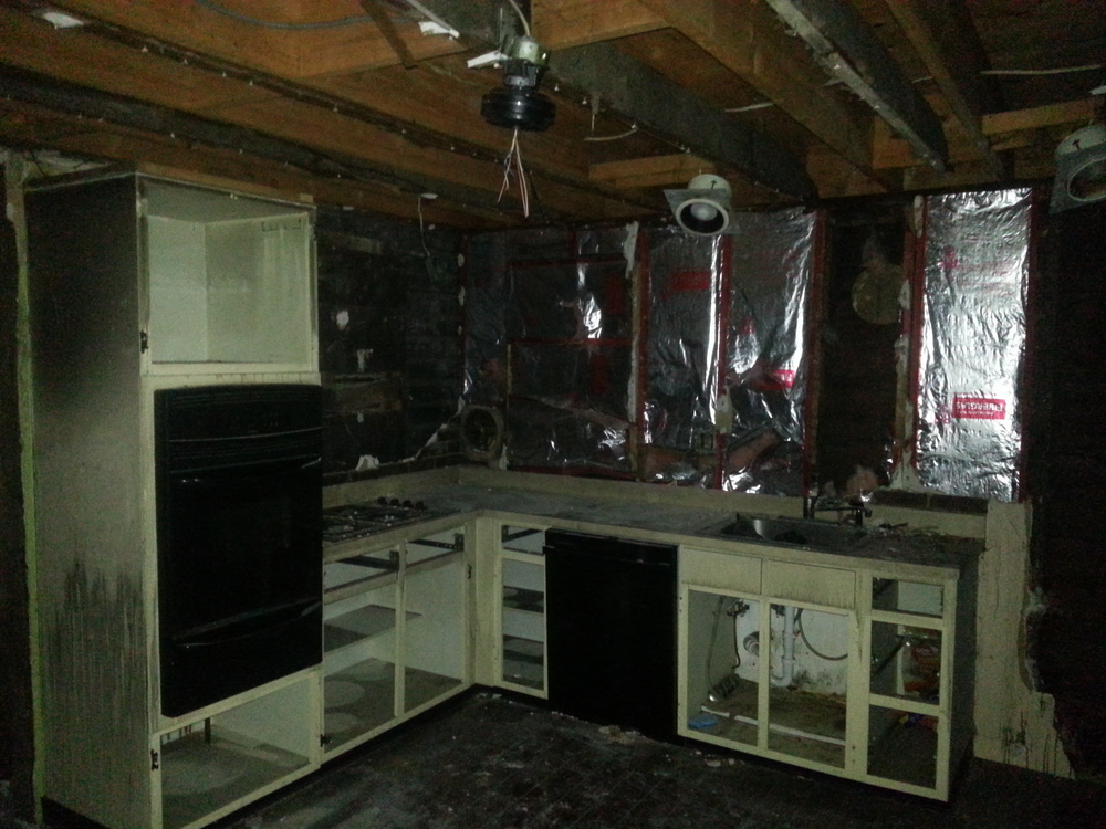 Fire damaged kitchen before restoration by Groundswell Contracting