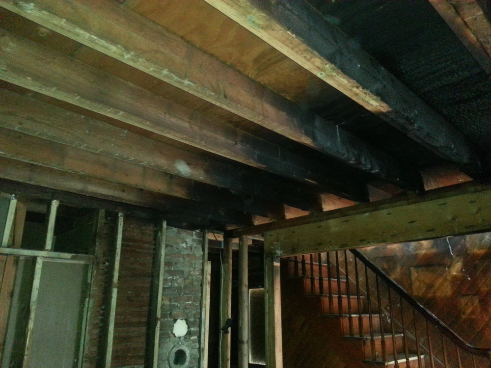 Fire damaged interior before restoration by Groundswell Contracting