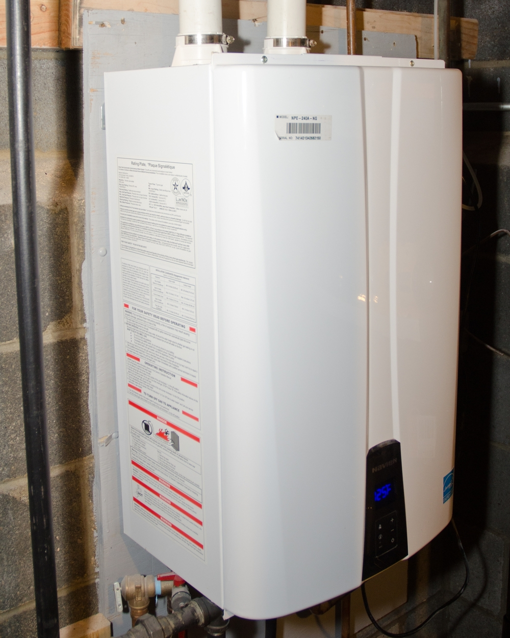 On demand hot water heater.  Unlike a standard tank hot water heater that fires consistently to maintain tank temperature, our installed Navien NPE 240-A doesn't utilize any significant amount of energy unless hot water is being used.  It is also direct vented to the exterior putting the Carbon Monoxide outside and alleviating orphaned hot water heater issues such as spillage. Points for IAQ and Energy Use Reduction.