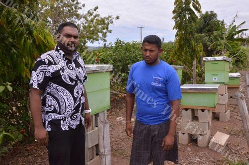 Empower Pacific income generating officer Nafiz Mohammed with Ashneel Ram and the beekeeping equipment at his Drasa farm in Lautoka. Picture: BALJEET SINGH