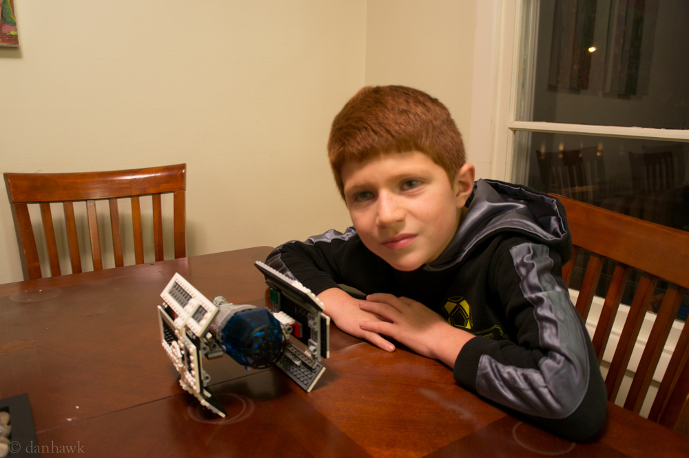 Caedon and his tie fighter.jpg