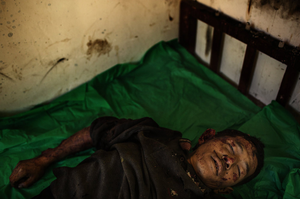 The body of deceased Maji Tu Ja, 40,  lies in a mortuary in Laiza Hospital in northern Myanmar. Maji Tu Ja was a farmer and village militiaman who was killed from Burmese Army mortars  whilst repairing his tractor in a field. Three other civilians were wounded in the same attack - two of them seriously.