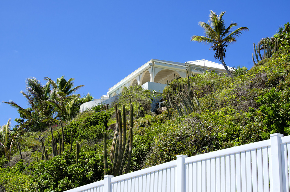 Villa Oyster Pearl, nestled on the hillside as seen from the beach.