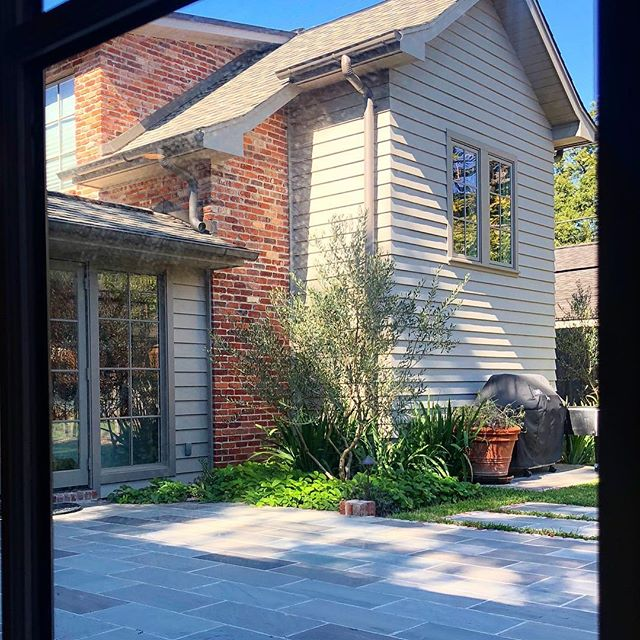 Garage addition viewed from the living room at our Longmont Reno. PM: @potts5457 Architect: @cusimanoarchitect . . . . . #houstonbuilder #apbuilders #custombuilder #remodel #renovation #addition #homeaddition #garageaddition #bluestone #artisansiding #jameshardie @marvinwindows